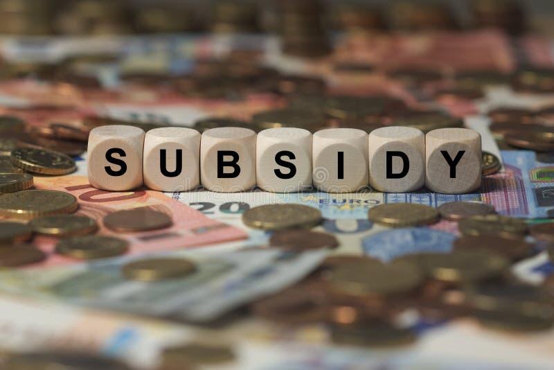 Subvention - cube avec des lettres, signe avec les cubes en bois photographie stock libre de droits