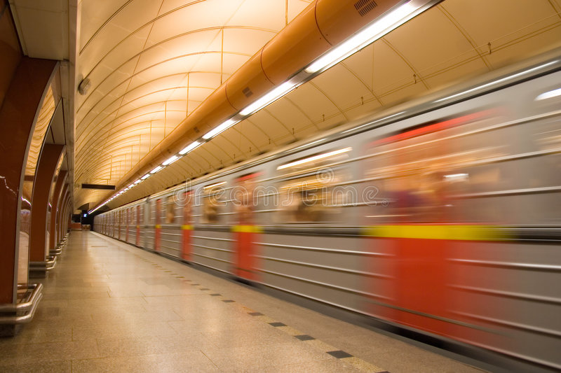 Subway. Station platform with train passing by royalty free stock image
