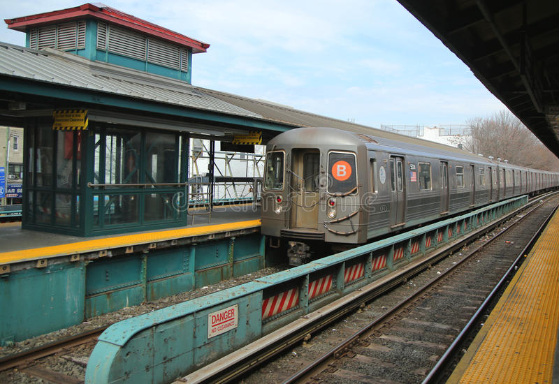 Subway B Train arriving at Kings Highway Station in Brooklyn stock images