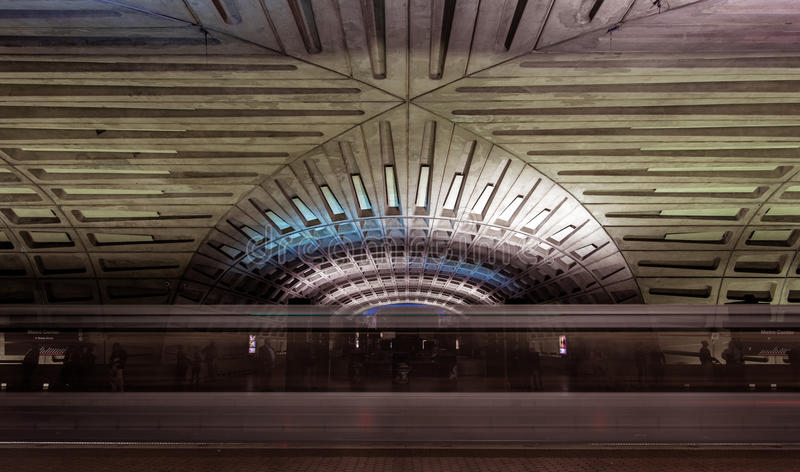 Subway blur and dramatic ceiling of the Washington DC Metro stat. Subway blur and dramatic vaulted ceiling of the Washington DC metro station royalty free stock images