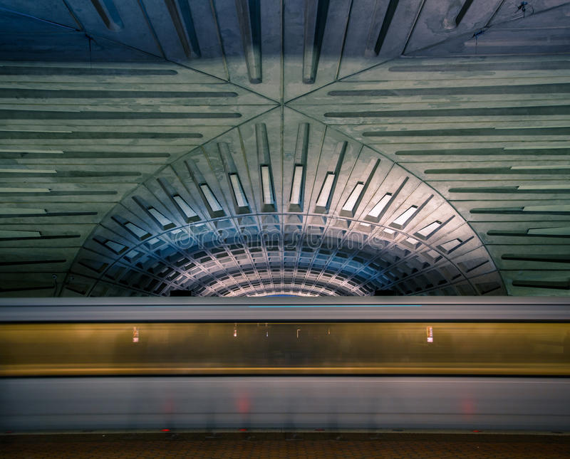 Subway blur in the Washington DC metro station. Subway blur and dramatic vaulted ceiling of the Washington DC metro station royalty free stock image