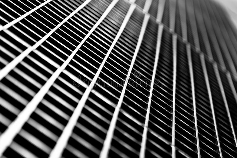 Subway Grate Closeup. Black and white close up of a sidewalk subway grate with shallow depth of field stock photo