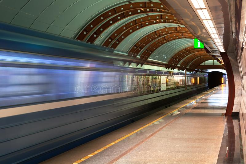 Subway station. Diagonal blue motion blur metro train background. Train departure. Fast underground subway train while stock photography