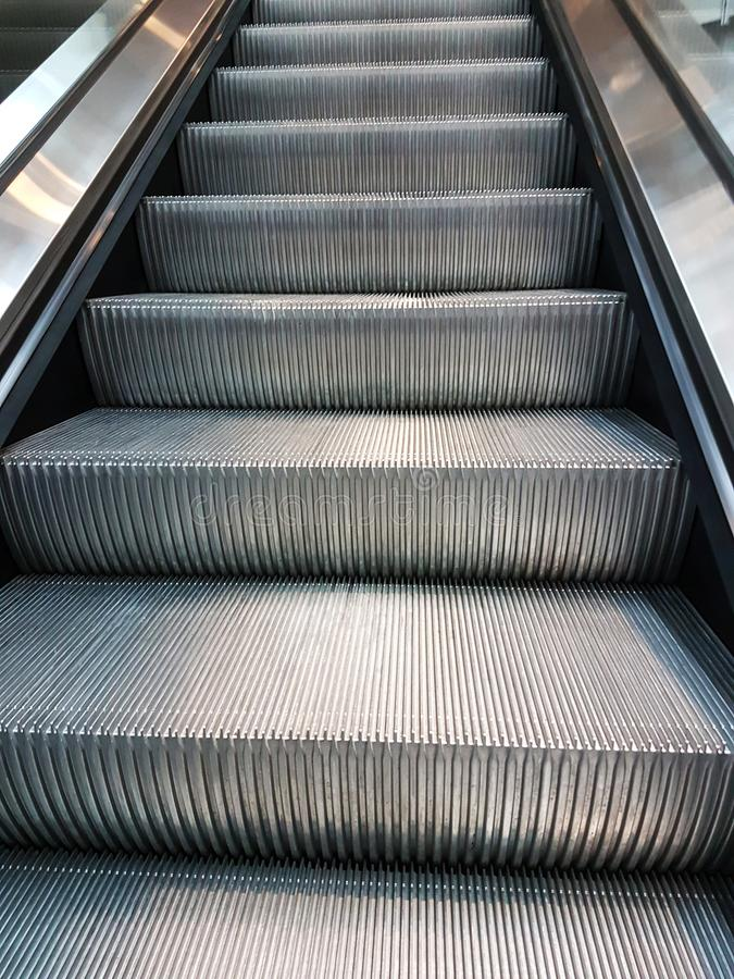 Metal escalator stairs royalty free stock photo