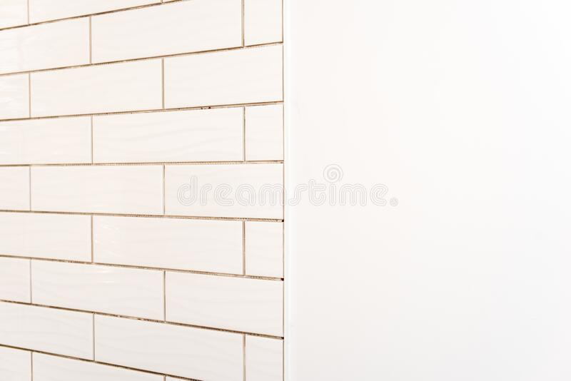 Subway tiles on shower wall stock photography