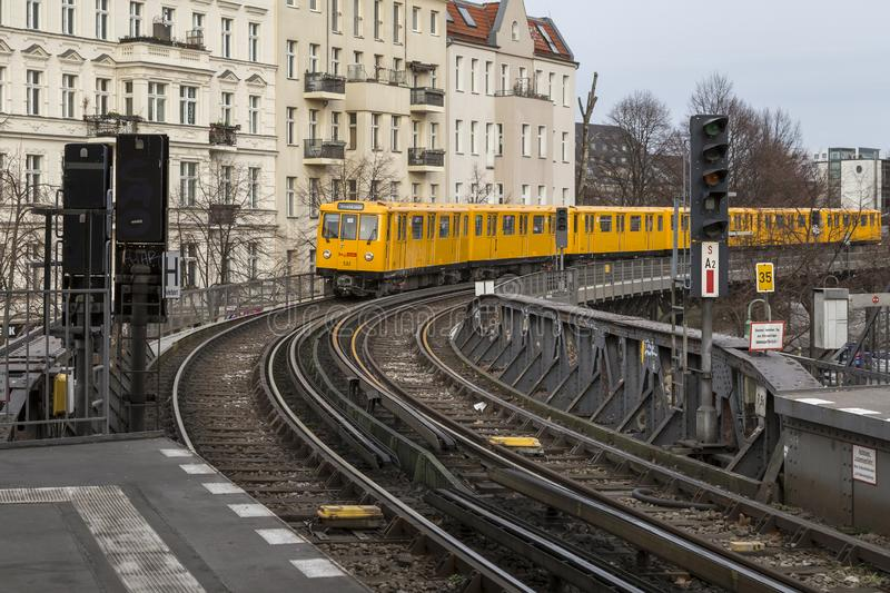 Subway train approaching a station in Berlin. Old yellow U-Bahn subway train approaching an overground station in Berlin, Germany stock photos