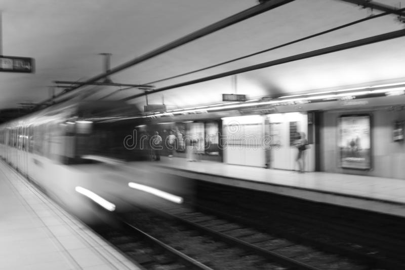 Subway train blurred in motion in underground station - Metro de Barcelona. Europe, move, journey, rapid, connections, construction, power, tunnel, electric royalty free stock photo