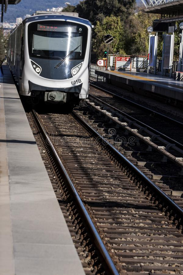 Subway train of the city of Izmir Turkey coming to the station - photography stock photos