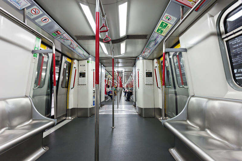 Subway train. HONG KONG - FEBRUARY 22: Subway train interior on FEBRUARY 22, 2012 in Hong Kong. Over 90% daily travelers use public transport. Its the highest royalty free stock image
