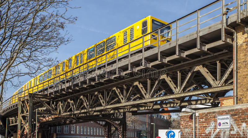 A Subway Train on the iron bridge under the working district it Berlin royalty free stock photos