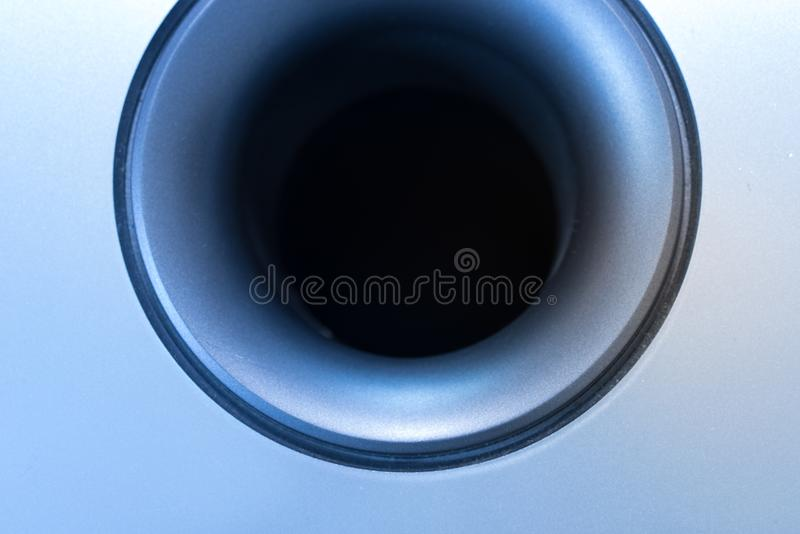 Subwoofer Detail with View Inside the Pipe. Part of a Subwoofer Loud Speaker with typical pipe and active funnel shaped output royalty free stock photo