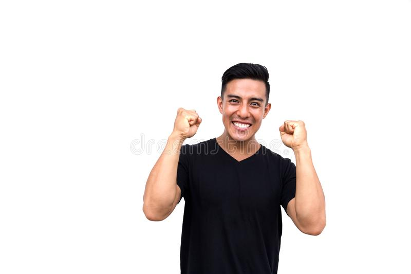 Succès de expression heureux et enthousiaste d'homme hispanique bel photos stock