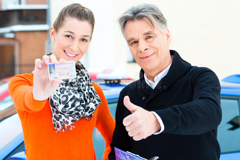 Succeeded - Student driver with driving instructor royalty free stock photo