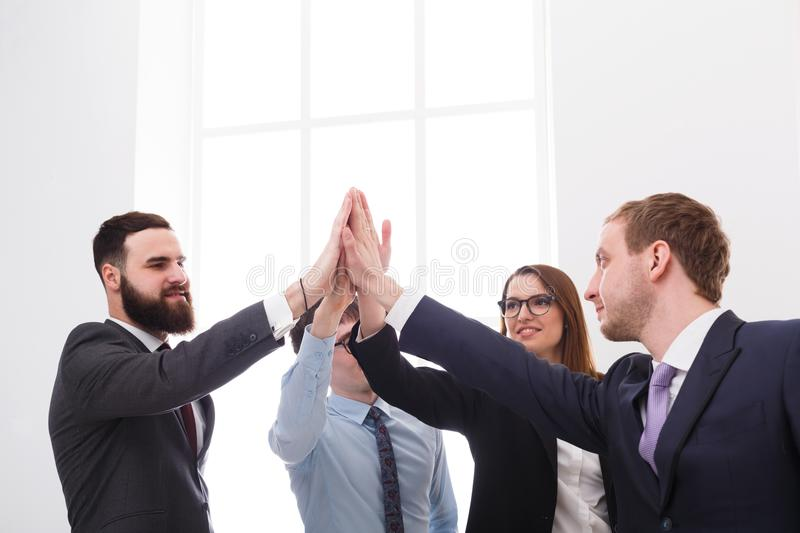 Team put hands together, connection, teambuilding and alliance concept. Succesful business people in office, young managers male and female unite hands for royalty free stock photo