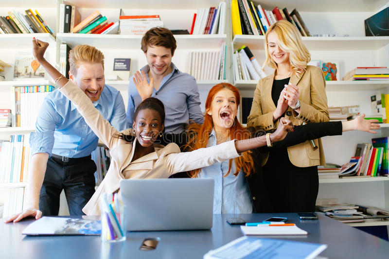 Succesful company celebrates business success. With coworkers being happy royalty free stock photography