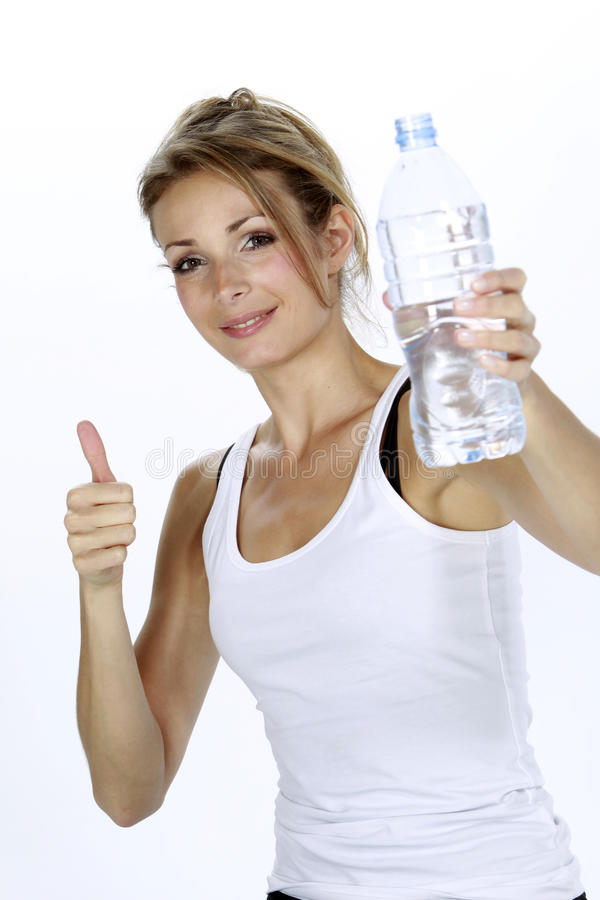 Succesfull woman drinking water royalty free stock photos