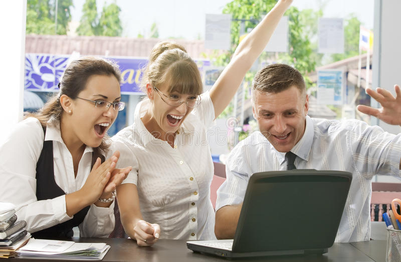Success. Portrait of young business people discussing project in office environment royalty free stock photography