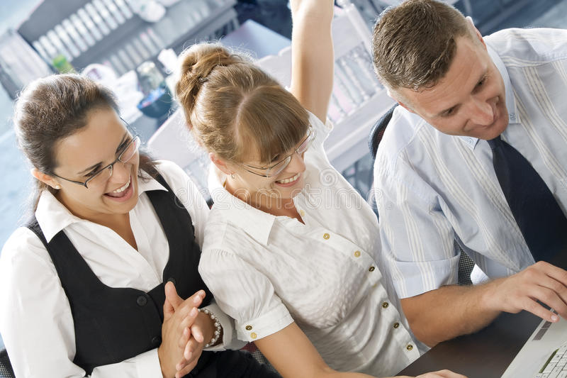 Success. Portrait of young business people discussing project in office environment stock photos