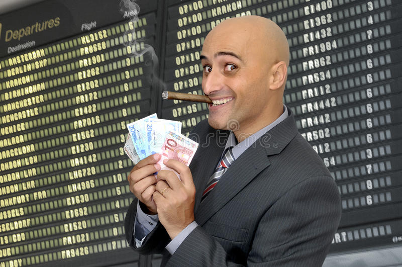 Success. Businessman with money and a cigar royalty free stock photos