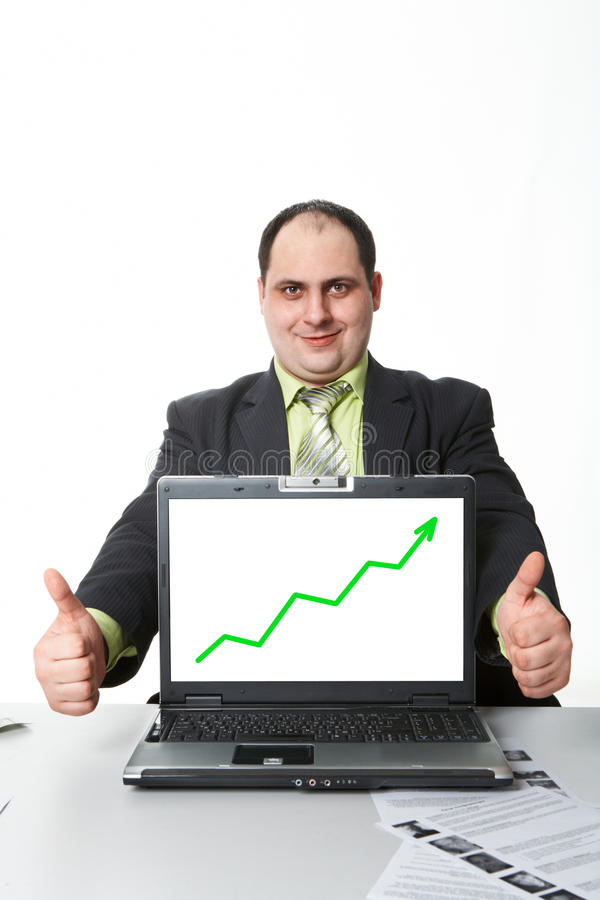 Success. Photo of middle aged employer showing thumbs up with rising graph on laptop screen royalty free stock images