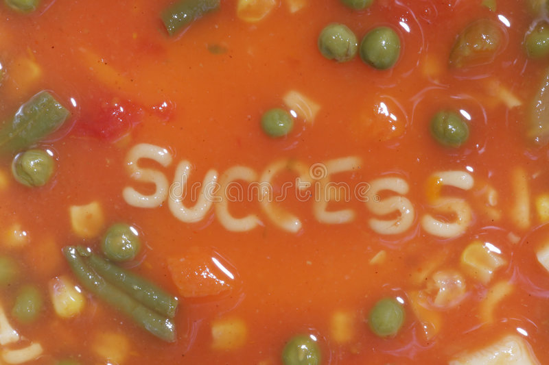 Success. A bowl of alphabet soup with the word success in the middle stock image