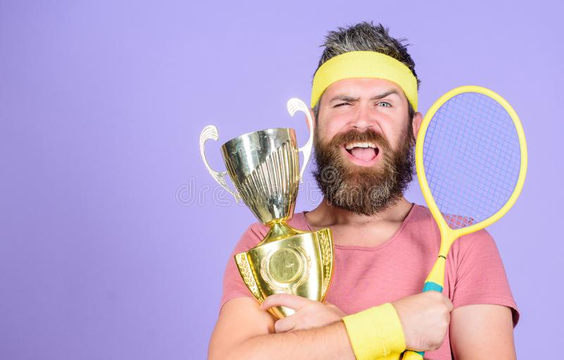 Success and achievement. Win tennis game. Win every tennis match i take part in. Tennis player win championship. Athlete. Hold tennis racket and golden goblet royalty free stock photography