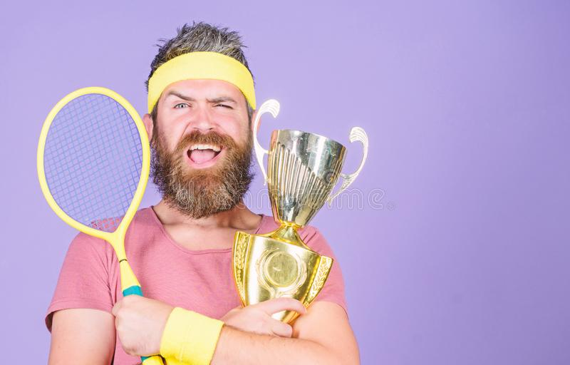 Success and achievement. Win tennis game. Win every tennis match i take part in. Tennis player win championship. Athlete. Hold tennis racket and golden goblet stock image