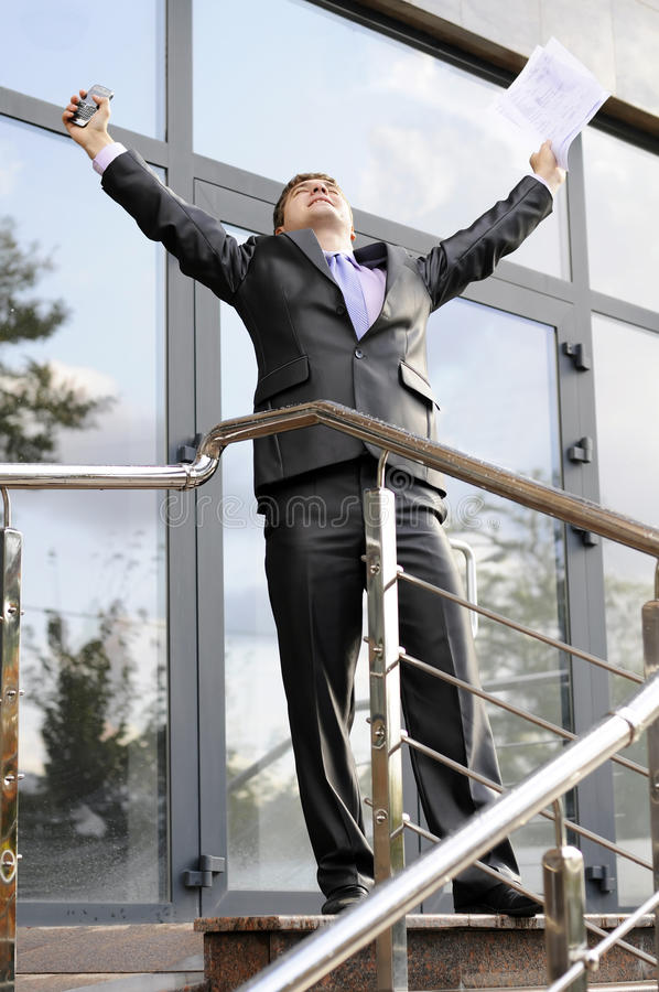 Success in business. Businessman enjoys his success in signing contract royalty free stock image