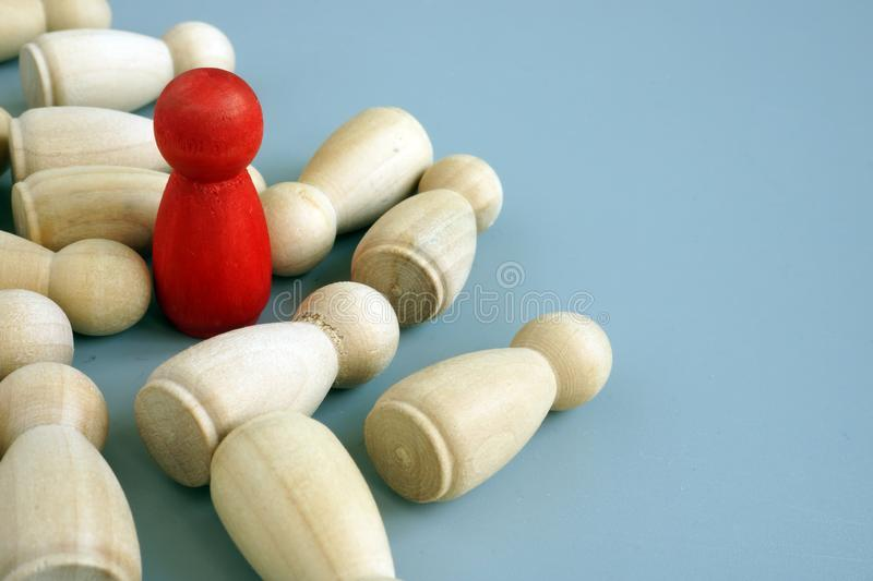 Success in business competition. Red figurine and wooden ones stock photo