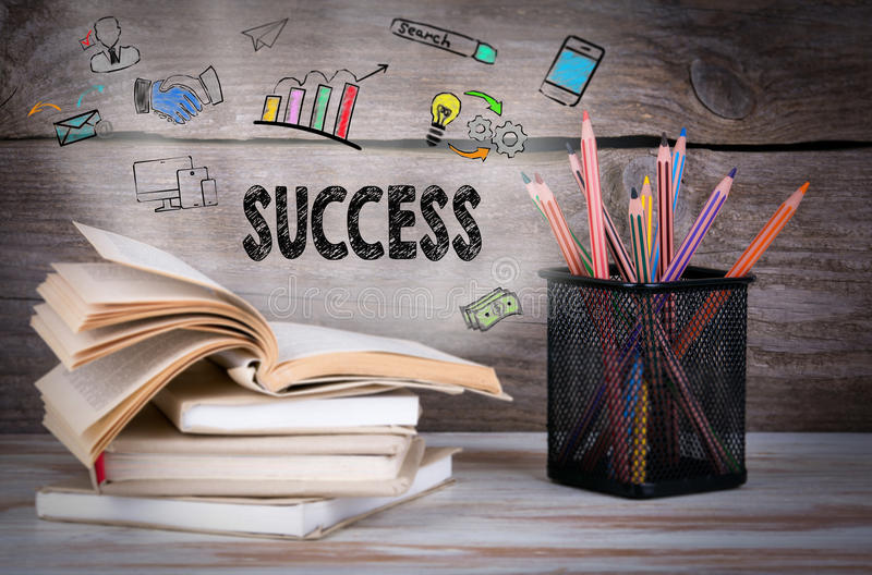 Success, Business Concept. Stack of books and pencils on the wooden table. stock image