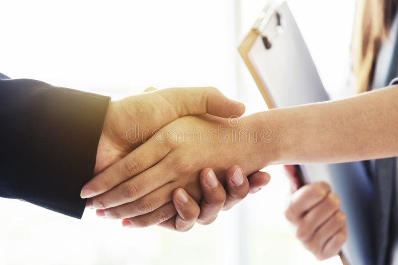 Success business deal concept. Closeup of business people handshaking after finished deal in office royalty free stock images