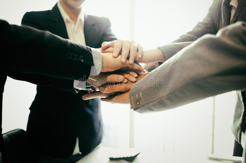 Success business partners shaking hands after complete a deal in office, success deal and strategy concept stock photography