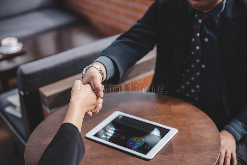 Success business and partnership business concept, Business people shake hands to agree to join business royalty free stock images