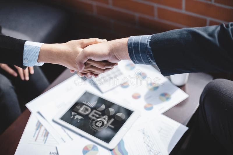 Success business and partnership business concept, Business people shake hands to agree to join business stock image