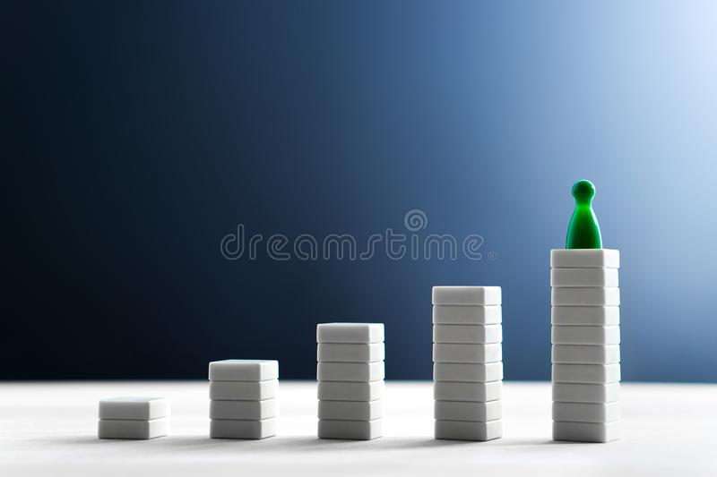 Success in business, reaching goals, leading and being the best. Concept. Climbing and standing on the highest top. Growing graph and diagram stock photos