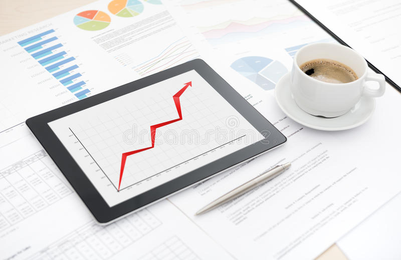 Success business report on apple ipad stock photos