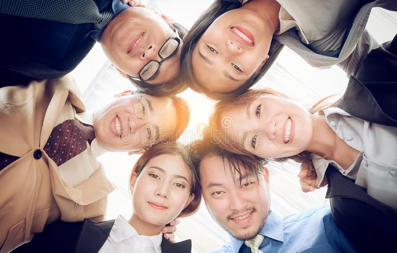 Success business team ,Businesspeople putting heads togeth stock photo
