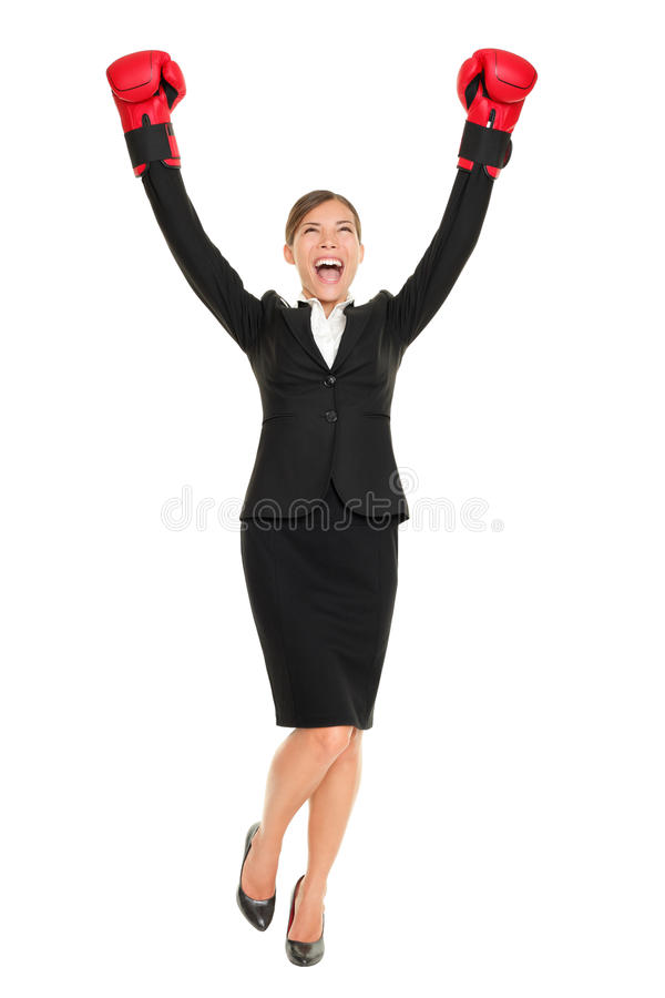 Success business woman standing. Cheering with arms in air wearing boxing gloves - business concept with businesswoman in full body celebrating happy. Young stock images