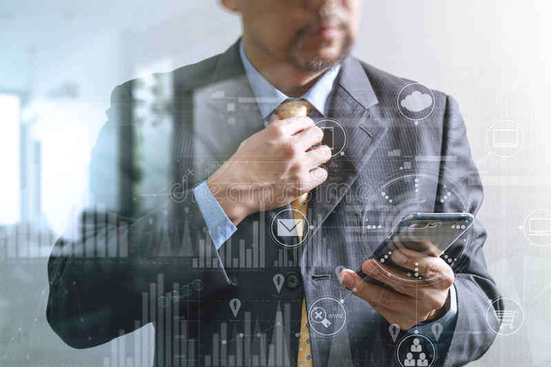 success businessman holding tie and using smart phone,thinking,front view,filter effect,omni chanennle and business strategy icon stock photography