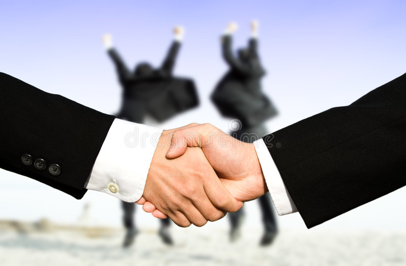 Success businessmen shaking hands stock photo