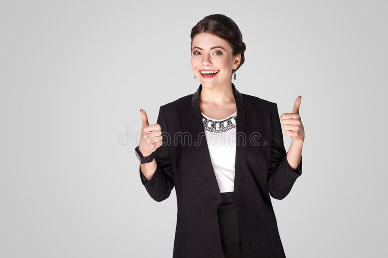 Success businesswoman showing like sign, thumbs up royalty free stock photos