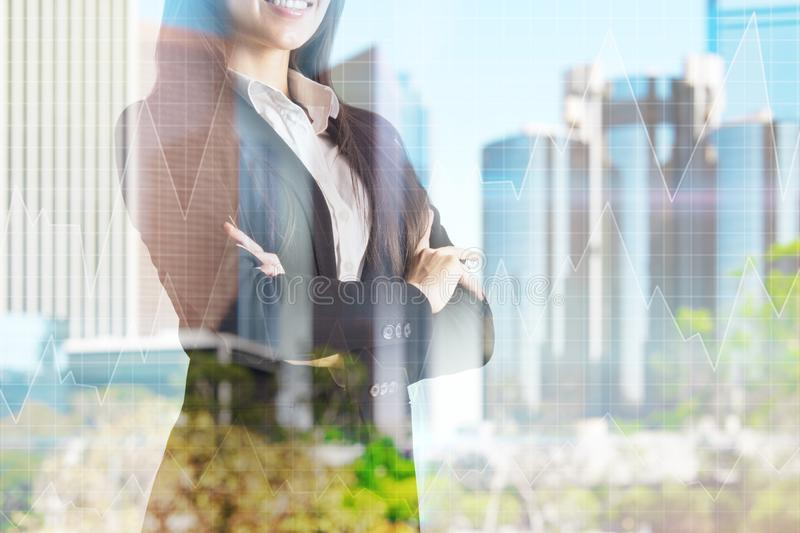 Success, career and inspire concept. Happy young european businesswoman with folded arms standing on blurry city background. Success, career and inspire concept royalty free stock photography