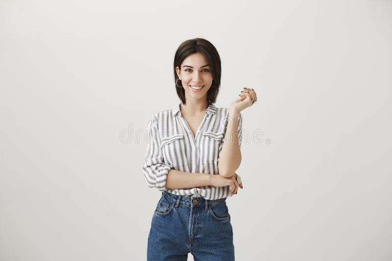 Success comes with right attitude. Portrait of good-looking confident and dominating woman with bright smile, standing stock photography