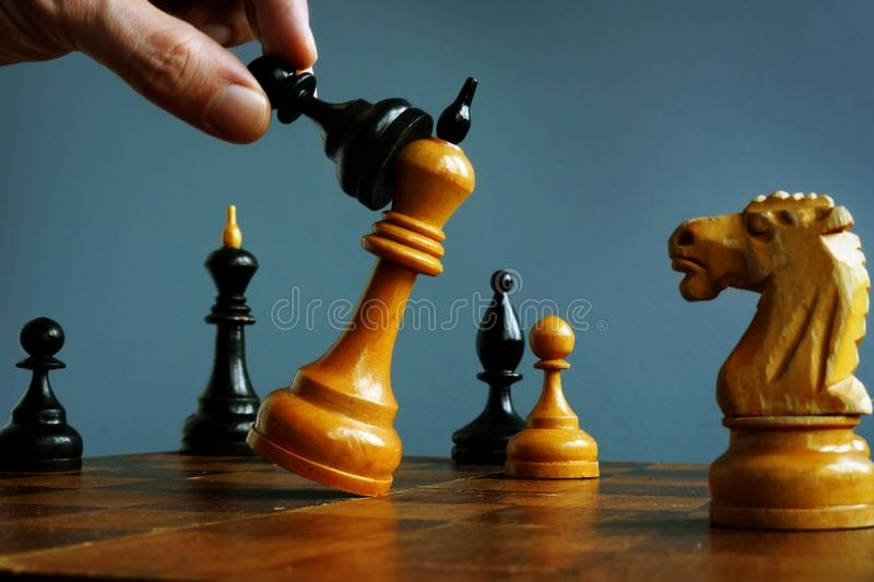 Success in competition strategy. Business challenge. Pawn wins in a game with king royalty free stock image