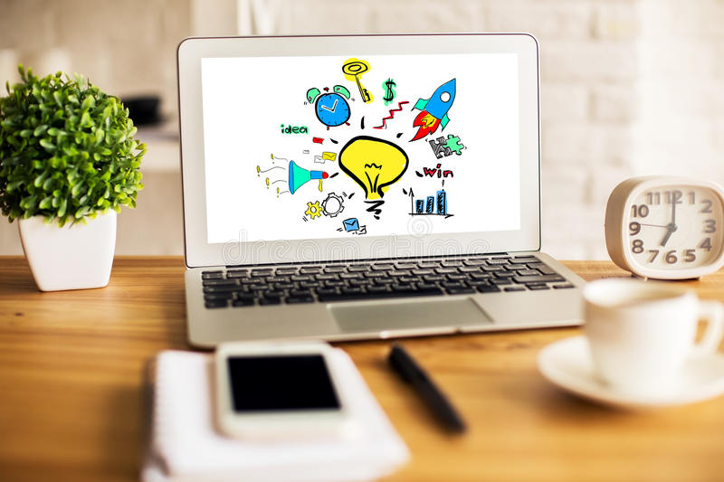 Success concept. Close up of workplace with creative business sketch on laptop screen, coffee cup, plant, smartphone and other items. Success concept stock image