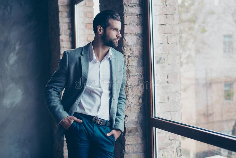 Success concept. Stylish young bearded man is standing near the stock photo