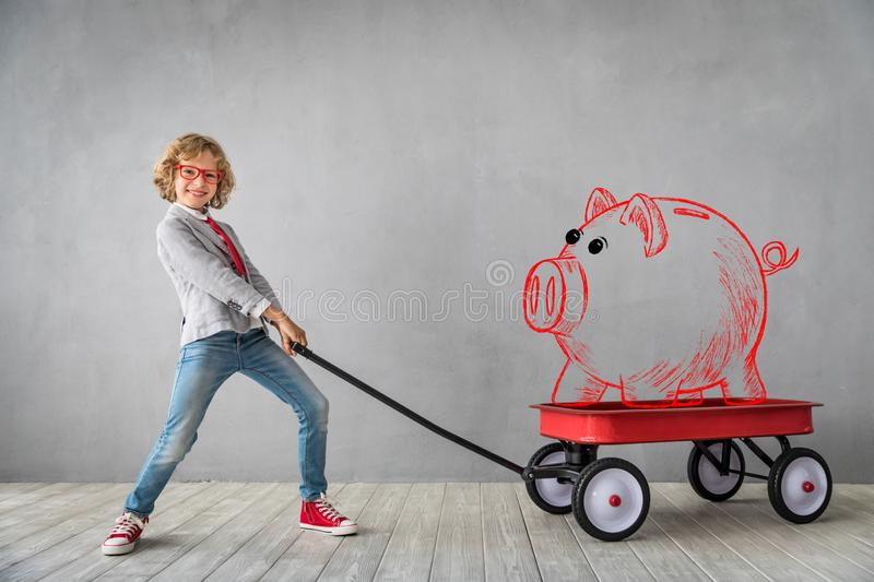 Success, creative and idea concept. Child with piggy bank. Success, creative and idea concept royalty free stock image