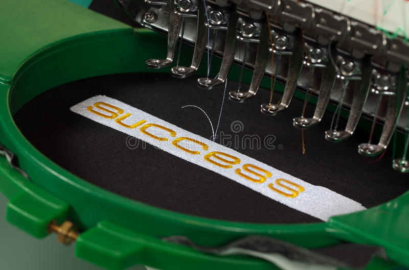 Success embroidery stock photos