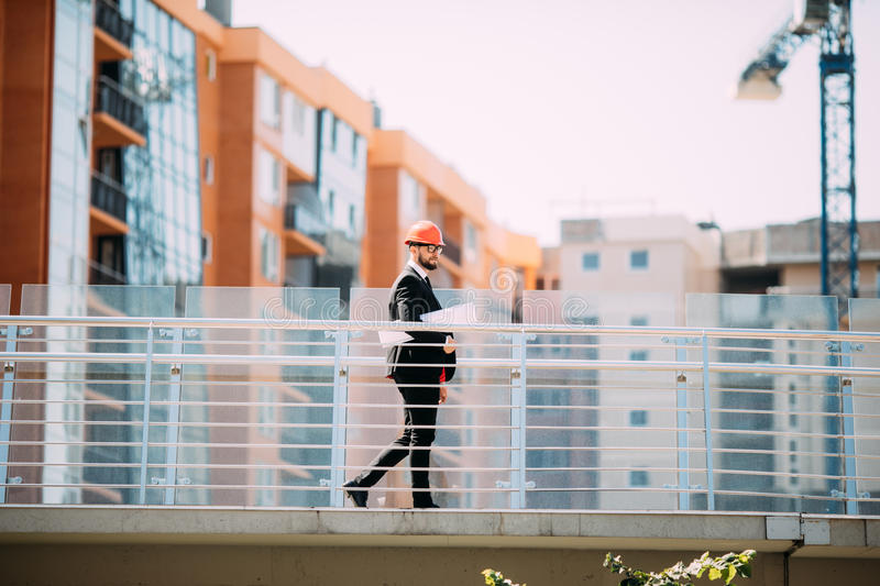 Success Engineer wear white helmet for safety and checking building plans blue print. stock photography