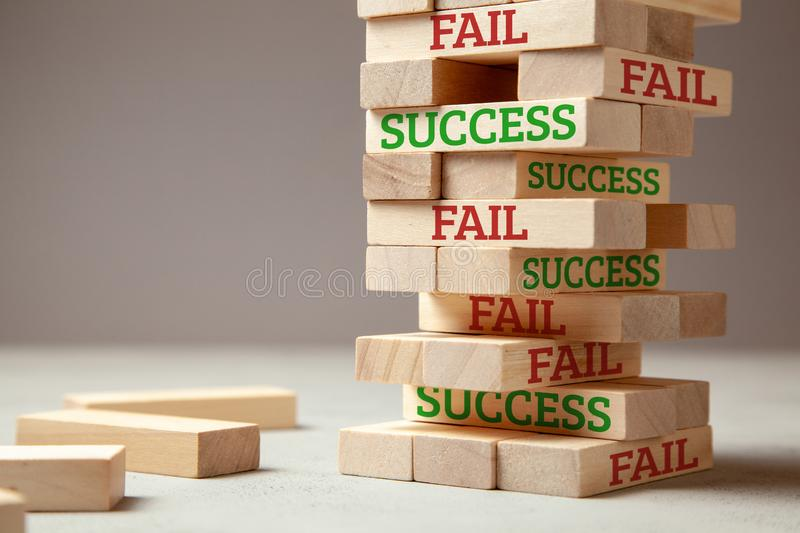 Success and fail. Wooden tower of blocks. Failure is like new step for success. Failure gives experience and makes you successful royalty free stock image